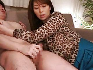 Lusty milf strokes cock