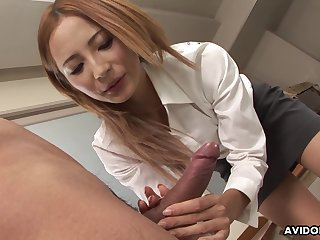 Asian blonde Shiori Ayase gives a nice handjob in the office